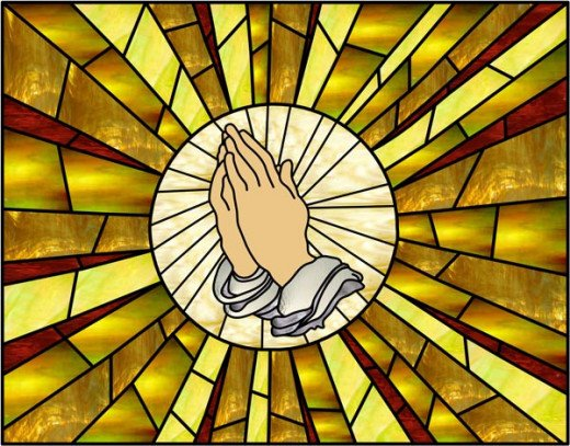 Praying hands in stained glass, because everyone knows there is only one proper way to pray.