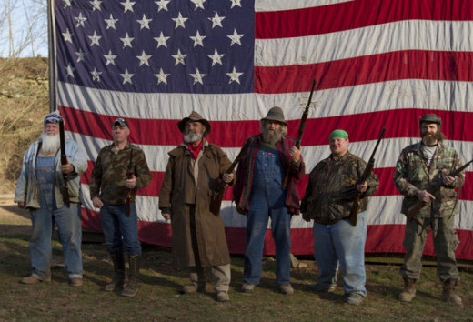 "A.I.M.S. team from left, Jeff Headlee, research, ""Wild Bill"" Neff, expert tracker, John ""Trapper"" Tice, team leader, ""Huckleberry"" Lott, security, and Willy McQuillian"