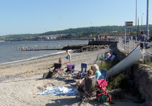 Enjoying the beach at Rhos on Sea,  Wales. The Jetty has lots of children fishing for crabs