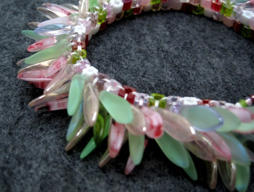 Pink and green garden dagger fringed beaded bracelet.