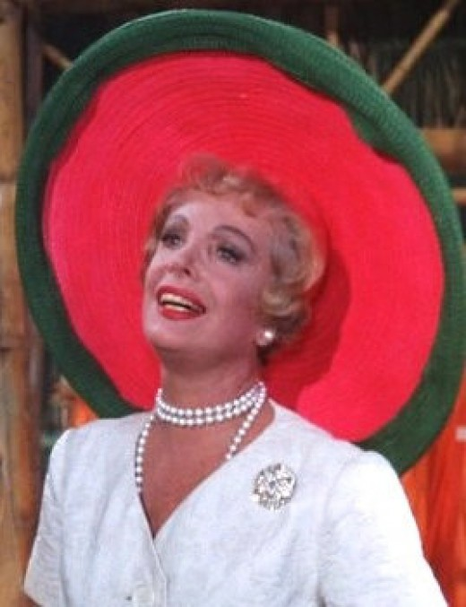 A film screenshot showing Natalie Schafer as Lovey Howell, the millionaire's wife from Gilligan's Island