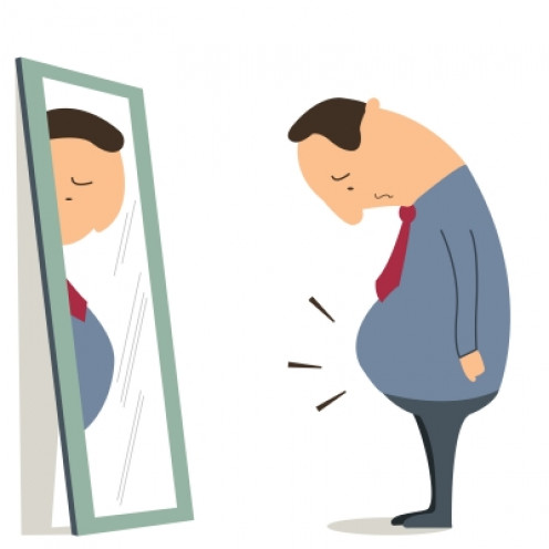 A man with belly fat in front of a mirror