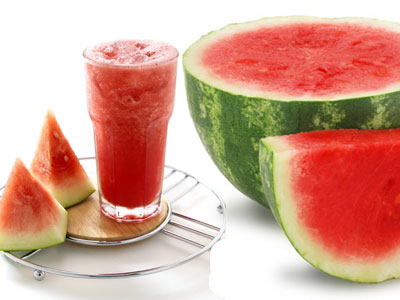 Water melon and a cup of water melon juice