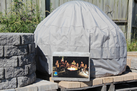 Accessorizing with a fire pit cover.