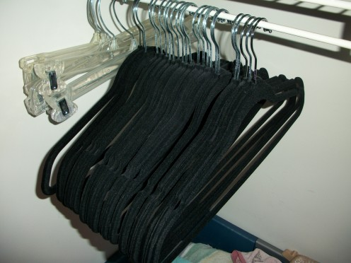 Velvet clothes hangers prevent your garments from slipping off to the floor. They are inexpensive and come in a variety of colors. They also have dents in them on the top rungs to further keep garments in place.