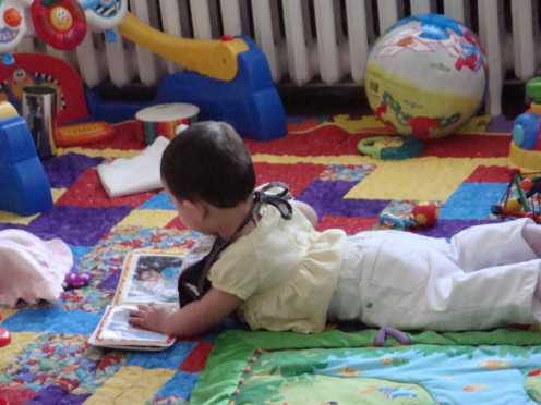 Tummy time while looking at family photo book