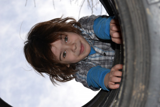 The boy and his tires, he loves climbing through them
