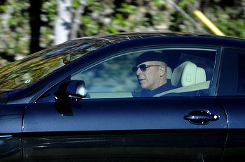 This is Bruce Willis driving a car