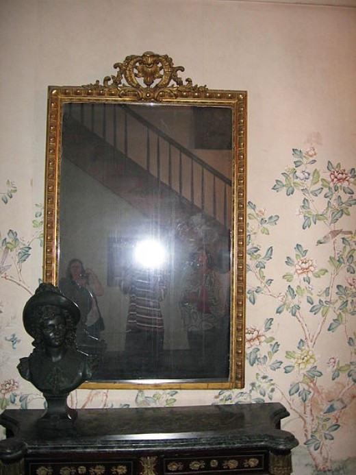 The haunted mirror at the Old Myrtles Plantation where three souls are said to be held captive.