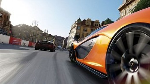 A race between a couple of 2013 Ferrari sports cars in Forza Motorsport 5