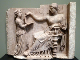 Gravestone of a Woman with Her Attendant (Greek, c. 100 BC). The hinged object was possibly a jewelry box, mirror, or wax writing tablet (probably not a laptop computer).Uploaded by Marcus Cyron Author;Dave & Margie Hill / Kleerup from Centennial, CO