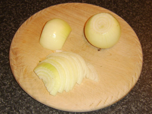 Slicing onions for adding to Indian spiced sauce