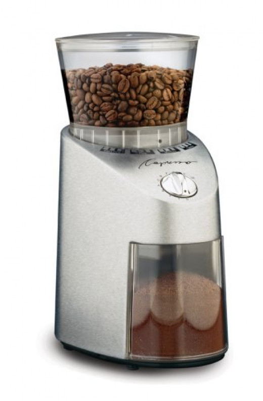 Capresso Infinity Conical Burr Grinder.  Quiet and accurate, conical burrs are generally accepted to be the best type.  They are also the least messy than wheel grinders, as the grinder wheel doesn't need to turn so fast.