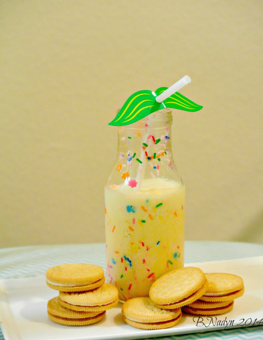 Pour in the milkshake.  Add whip cream at top with more sprinkles, if desired.  (Inspired from smartschoolhouse.com).