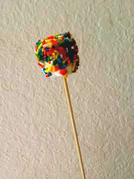 Marshmallow pops are easy and fun party foods: Insert a lollipop stick or bamboo skewer into a jumbo marshmallow, dip in a bowl of water and sprinkle.