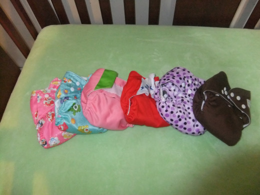 A range of China cheapie diapers including JC Trade, Happy Flute, and Alva