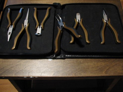 an assortment of small pliers and wire cutters