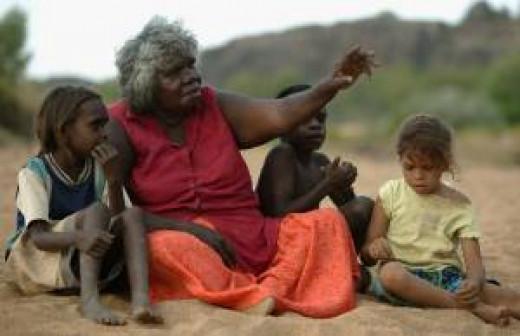 An Aborigine woman telling children stories