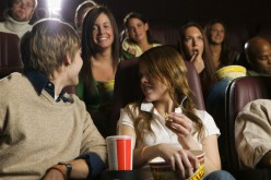 Openly-flirting with other girls is totally-unacceptable in a movie theater.