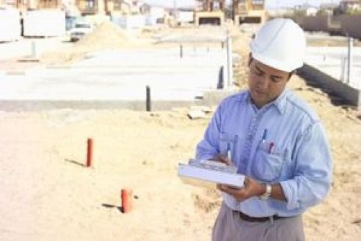 A commercial building inspector at work either performing a code inspection or a construction draw inspection.