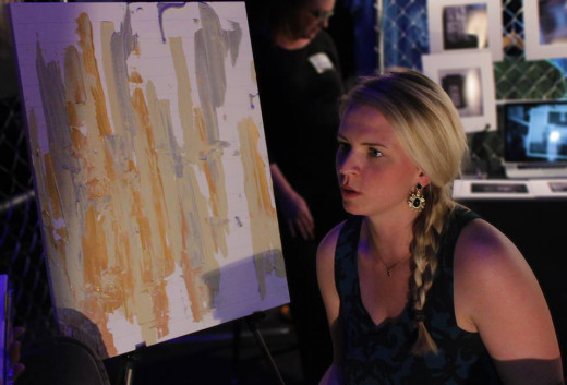 Lindsay Kosma takes a moment from her live art to talk about her experience with RAW.