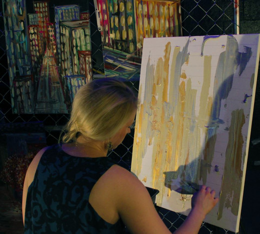 Kosma working on her live painting throughout the evening.