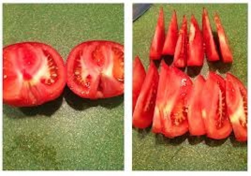 Cut tomatoes into wedges in order to complete your dish.