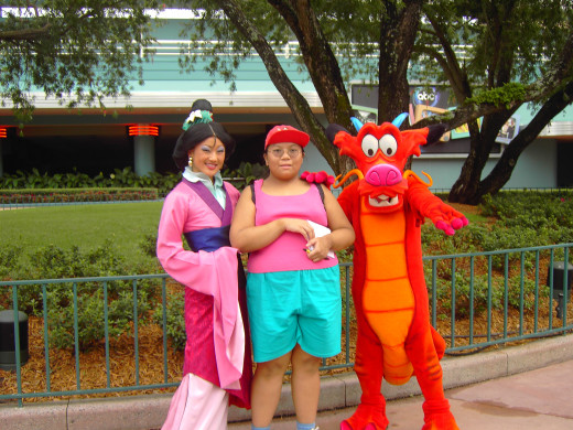 Me with a Disney princess (here, it's Mulan, with the dragon Mushu), October 2006.