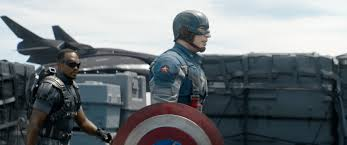 """Anthony Mackie is Sam Wilson (aka The Falcon) and Chris Evans is Steve Rogers, the hero better known as Captain America in the sequel movie subtitled """"The Winter Soldier""""."""