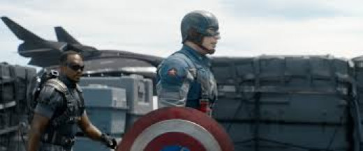 "Anthony Mackie is Sam Wilson (aka The Falcon) and Chris Evans is Steve Rogers, the hero better known as Captain America in the sequel movie subtitled ""The Winter Soldier""."