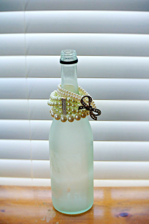Wine bottles can be used to hold jewelry like bracelets.  Decorate or paint the bottle to match your bedroom or dresser.
