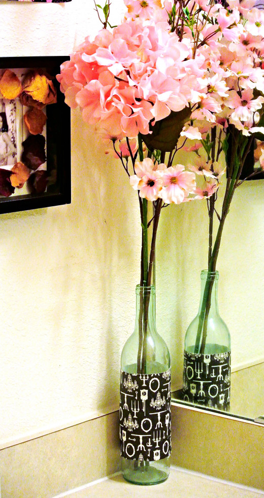 I like using wine bottles as vases for house decor.