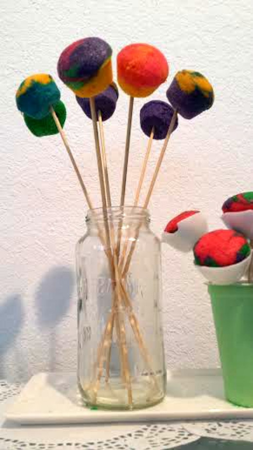 Jars are useful to hold food like cake pops on the table.