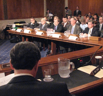 This photo is a portrayal of  a United States Senate committee where a new form of rhetoric, somewhat different than that of Aristotle is often displayed.