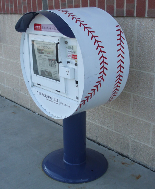 The local newspaper (The Morning Call) has a   cleverly designed vending box in the shape of a baseball.