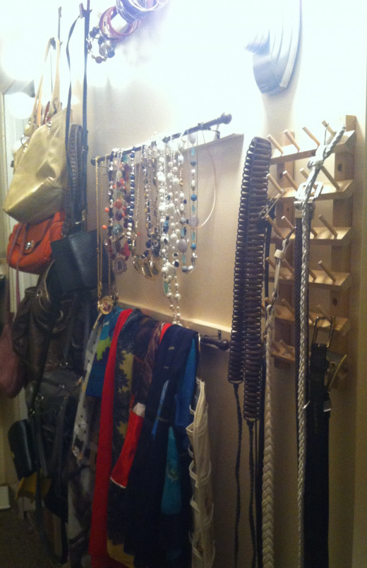 A place for purses, belts, scarves, necklaces, and a third rod can be added for bracelets