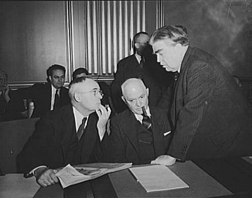 War Labor Board Anthracite Hearing (1943). John L. Lewis (right) confers with Thomas Kennedy (left),  UMW Secretary-Treasurer, and Pery Tetlow (center) UMW District 17 President.  Photo taken at the War Labor Board.