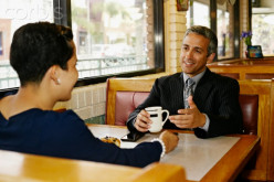 The man with the cup of coffee has an embarrassing eating problem and chose to meet his client one-on-one and just drink coffee as to not lose the client's business.
