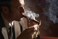 What fool lights-up a stogie at an important meeting with his company's oldest client?