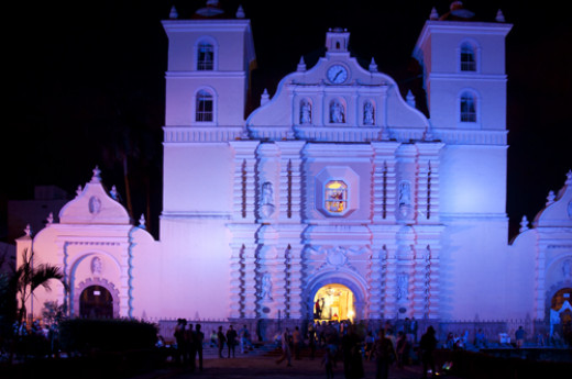 Facade of Cathedral of Saint Michael Archangel, at night with colored lights