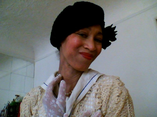 Victoria Moore in tap costume-off-white crocheted jacket over a vintage sailor top, with a black beret and white gloves