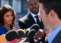 A city official answers questions from the press.