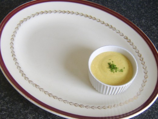 Turmeric and garlic dip is plated in a small ramekin