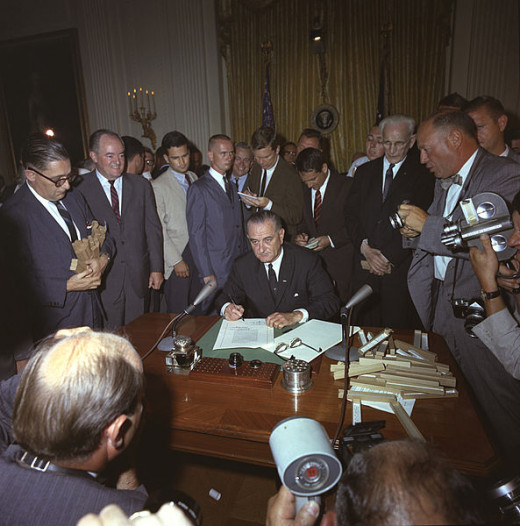 President Lyndon Baines Johnson signed the 1964 Civil Rights Act into law.