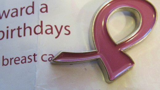 "Pink Breast Cancer Ribbon Pin I was given at the American Cancer Society's ""Making Strides Against Breast Cancer"" event."