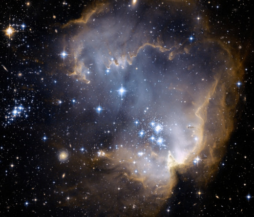 NGC 602, open cluster of stars located in the Small Magellanic Cloud, as seen from space