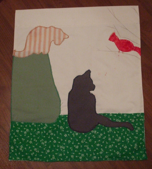 This custom flag features my 2 cats and a cardinal.