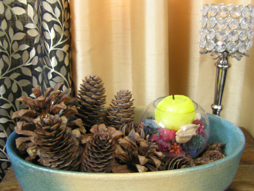 Pine cones grouped with candles