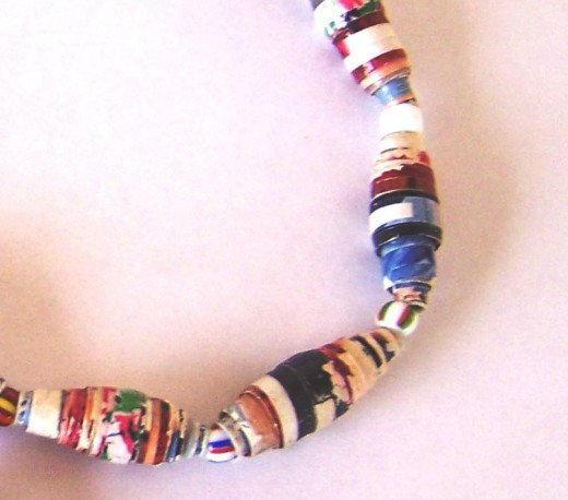 Close up of paper beads made from recycled magazines
