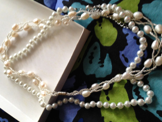 Fake pearls can look very similar to real pearls. Can you tell which is fake and which is real?